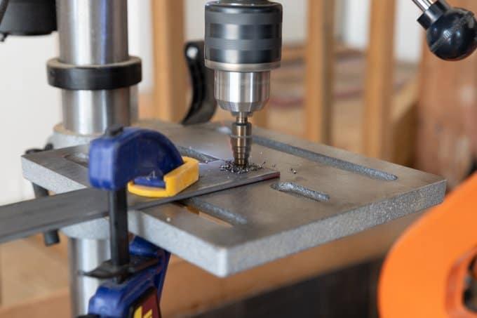 Step drill bit to cut metal